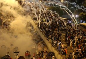 Police fire tear gas upon pro-democracy demonstrators near the Hong Kong government headquarters.