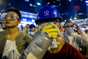 A pro-democracy protester tries to protect himself from tear gas during a demonstration in Hong Kong.