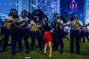 A pro-democracy protester confronts the police during a demonstration in Hong Kong.