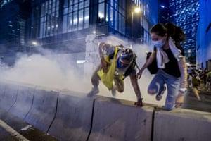Pro-democracy run away during a demonstration in Hong Kong.