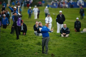 Rory McIlroy pitches onto the 14th green