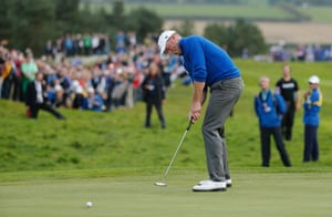 Jamie Donaldson putts on the 14th green