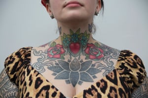 Nic Smith poses to show her body art during the 10th International Tattoo Convention in London