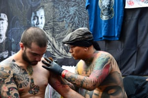 Ching tattooing at the London Tattoo convention at Tobacco Dock.