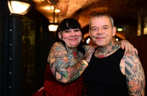 A couple pose as they attend the London Tattoo Convention at Tobacco Dock.