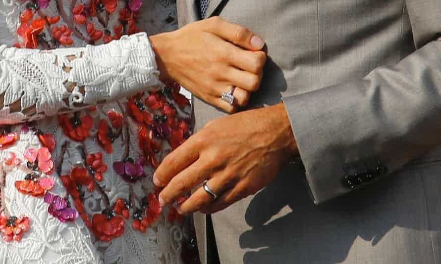 Wedding rings on the hands of George Clooney and his wife Amal Alamuddin.