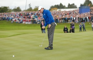 Rory McIlroy holes his birdie putt on the 1st to win the hole.