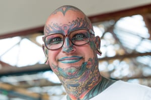 A person with their face tattooed attends the 10th London Tattoo Convention.