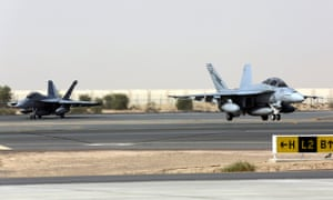 Royal Australian Air Force F/A-18F Super Hornets taxing off the runway after their arrival at Al Minhad Air Base in Dubai, United Arab Emirates.