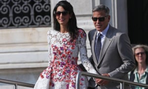 George Clooney (R) and his wife Amal Alamuddin (C) get on board of a taxi boat, in Venice
