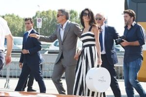 George Clooney and Amal Alamuddin leave the Aman Hotel on September 28, 2014 in Venice, Italy