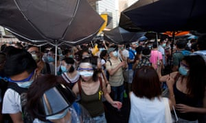 Pro-democracy protesters hold umbrellas against the threat of teargas and pepper spray in Hong Kong