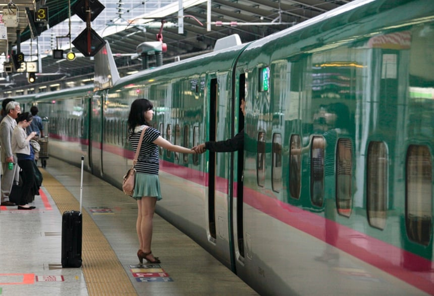A couple say goodbye as he leaves on the Tohoku Shinkansen bullet train from Tokyo.