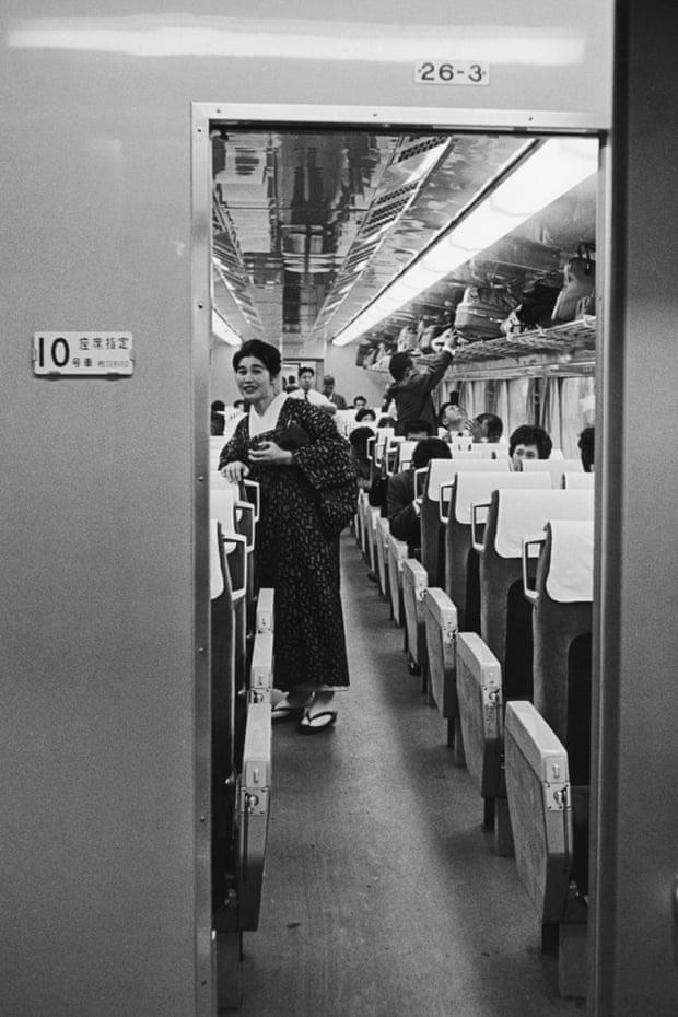 A passenger in traditional dress on board a Japanese hikari shinkansen bullet train in 1965.