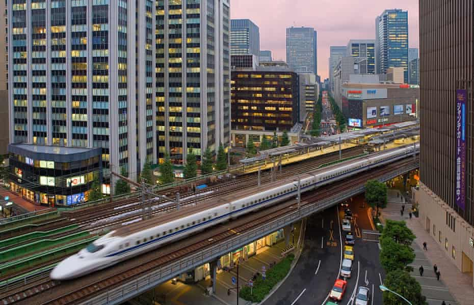 A Marunouchi Shinkansen bullet train passes through central Tokyo.