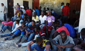 Illegal migrants rest after they were rescued by the Libyan coastguard when their boat sank off the coastal town of Garabulli, 60 km east of Tripoli on 15 September 2014.