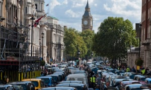 Taxi drivers block Whitehall during a demonstration in London, Britain, 24 September 2014. Taxi drivers participated in a protest against laws they say affect the safety of Londoners including competitors such as that allow mobile applications such as Uber.