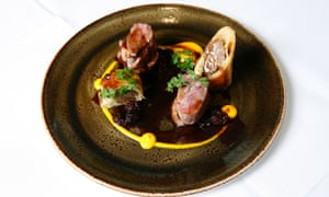 Roast duck breast on a plate with a thin circle of sauce