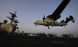 An aircraft lands after missions targeting Isis in Iraq from the deck of the US aircraft carrier USS George HW Bush in the Persian Gulf.