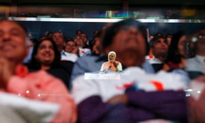 Prime Minister Narendra Modi of India is reflected in a glass barrier as he gives a speech during a reception by the Indian community in honor of his visit to the United States at Madison Square Garden.