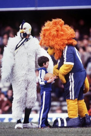 Stamford the Lion chats with a young Chelsea mascot