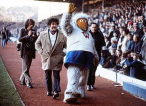 The Wimbledon 'Womble' mascot (it looks like it might be Tomsk) waves to the fans ahead of Wimbledon's 1974/75 4th round FA Cup tie against Leeds at Elland Road
