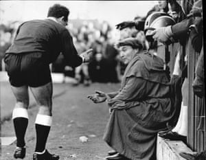 The Kettering mascot Cyril Wilson, who is dressed as Frier Tuck, gets sent off by referee Roy Sheppard for swearing at the Swansea goalkeeper Tony Millington in November 1969.