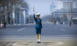 A traffic officer at an intersection in Pyongyang, where there are no traffic lights. Private cars are almost unheard of in North Korea.