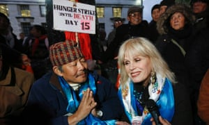 Former Gurkha Gyanraj Raj, a retired warrant officer in the British Army, bows with actress and advocate of Gurkhas' rights, Joanna Lumley after ending his hunger strike, opposite Downing Street in central London November 21, 2013.