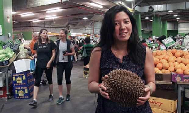 Monica Tan holding a monster durian.