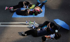 Student activists sleep on a road near the government headquarters where pro-democracy activists have gathered and made camp, Tuesday, Sept. 30, 2014 in Hong Kong.  (AP Photo/Wong Maye-E)