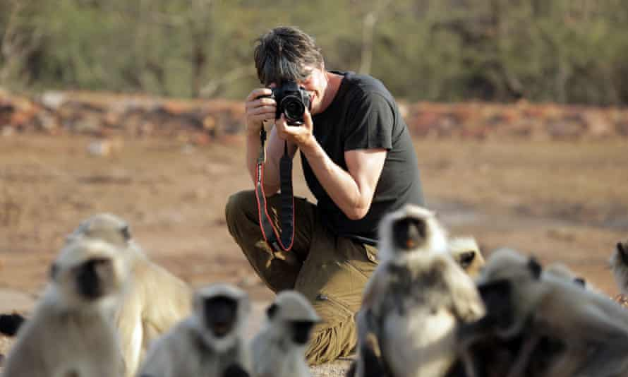 Down to earth: Brian Cox in BBC show Human Universe photographing monkeys