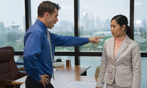 Businessman yelling at coworker