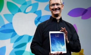Apple chief executive Tim Cook with iPad Air