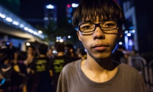 Seventeen year old student leader Joshua Wong outside the Hong Kong government offices