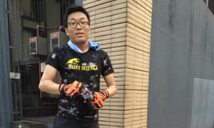 Casar Leung helps clean the street of rubbish