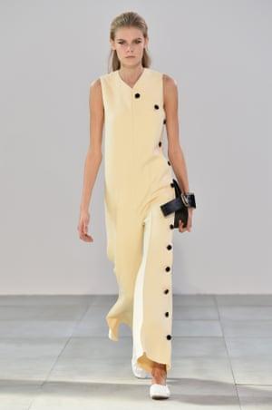 A model wears buttons on the Céline runway.