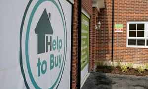 Marketing signs adorn the front of new homes on a housing development on May 20, 2014 in Middlewich, England.