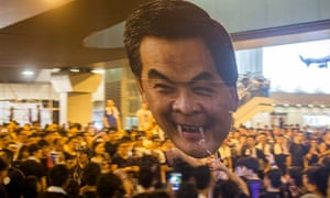 Pro-democracy protesters in Hong Kong hold up a giant cutout of Leung Chun-ying, whom they are calli