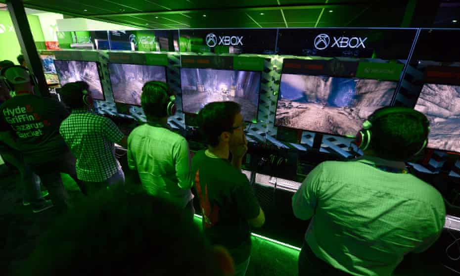 Gamers play the new 'Evolve' game at the Xbox exhibition.