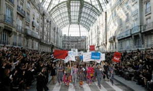 Models stage a 'feminist demonstration' at the Chanel show of Karl Lagerfeld, who once declared: 'No