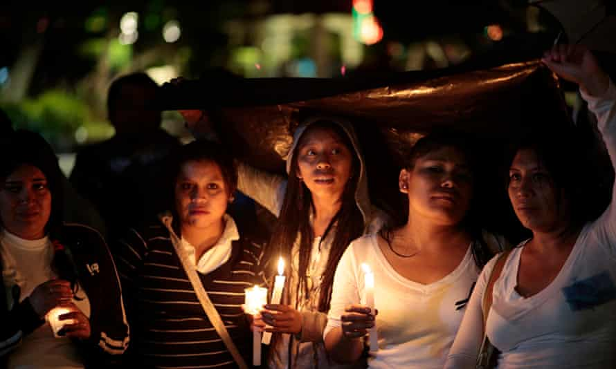Students from the Ayotzinapa teacher training college in Iguala hold a vigil to demand the safe retu