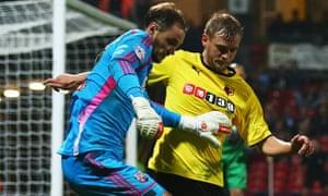 Watford's Joel Ekstrand and Brentford's David Button