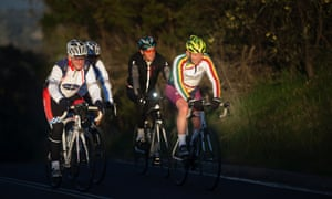 The Prime Minister Tony Abbott (yellow helmet) on his early morning bike ride this morning.