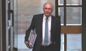 Acting PM Warren Truss enters the house.