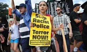 Demonstrators outside the Ferguson, Missouri, police department on 30 August.