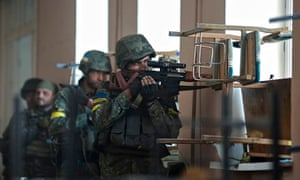 Ukrainian servicemen are seen at their position during fighting with pro-Russian separatists