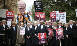 Barristers and solicitors hold a demonstration outside Parliament on March 7, 2014 in London. The government's cuts to legal aid have seen barristers withdraw their labour for the first time in history.