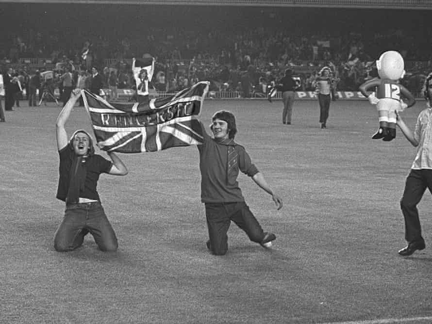Rangers fans invade the pitch after Colin Stein scores their side's first goal. Photograph: Colorsport/Rex