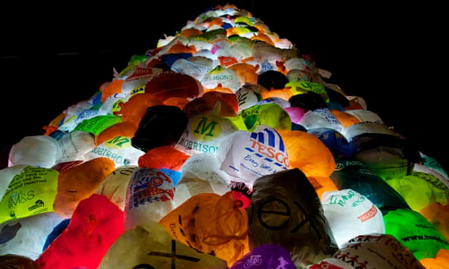 An illuminated Christmas tree constructed from recycled plastic shopping bags.